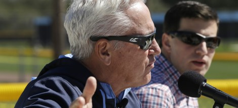 Tampa Bay Rays manager Joe Maddon, left, speaks with reporters as Rays general manager Andrew Friedman, right, looks on during a news conference following a spring training baseball practice Friday, Feb. 14, 2014, in Port Charlotte. (AP Photo/Steven Senne)