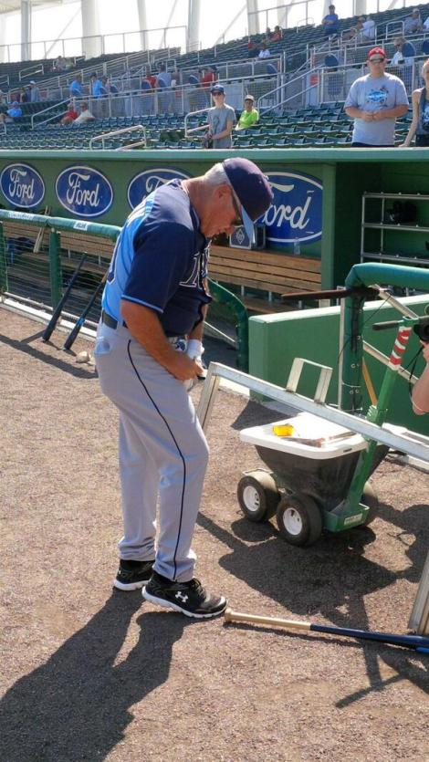 SUN PHOTO BY JOSH VITALE VIA TWITTER #Rays Joe Maddon signing some autographs during batting practice.