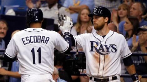 The Rays traded shortstop Yunel Escobar and infielder Ben Zobrist (right) to Oakland on Saturday.